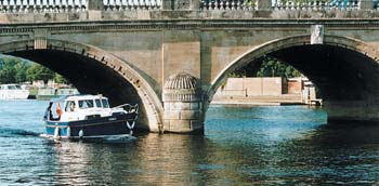 Boat under beautiful Henley Bridge.jpg
